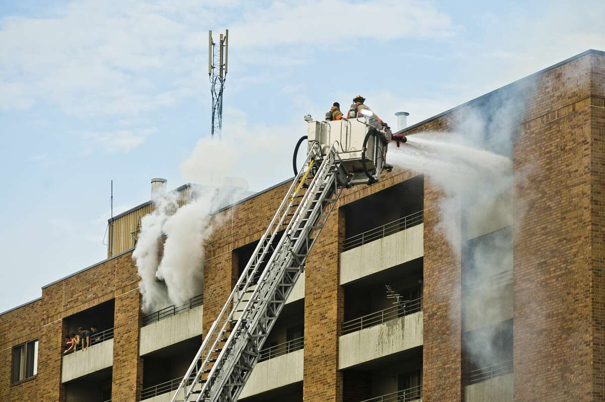 Midland firefighters battle a fire at Greenhill Apartments, 1010 Eastlawn Dr., on Monday, July 31, 2017 in Midland.