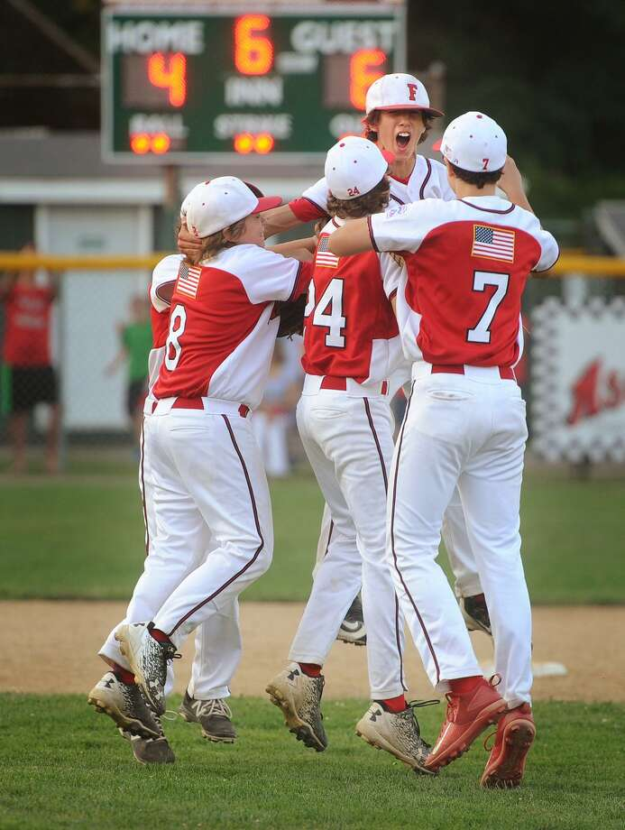 The Fairfield American baseball team celebrates their 6-4 victory over Newington in the Little League State Championship in Guilford, Conn. on Monday, July 31, 2017. Photo: Brian A. Pounds / Hearst Connecticut Media / Connecticut Post