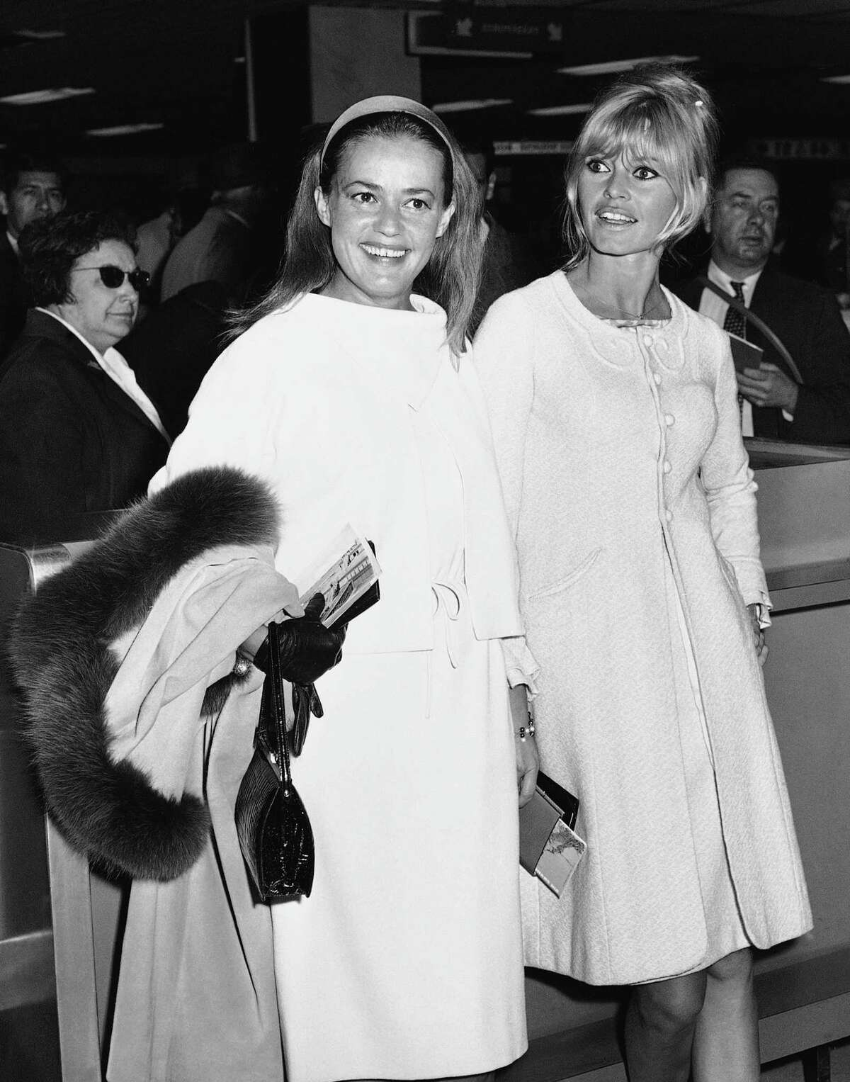 FILE - In this May 26, 1965 file photo Jeanne Moreau, left, and Brigitte Bardot are photographed as they arrive at Orly airport in Paris. French actress Jeanne Moreau, whose seven-decade career included work with Francois Truffaut, Orson Welles, Wim Wenders and other acclaimed directors, has died aged 89 it was announced Monday July 31, 2017. (AP Photo/File) ORG XMIT: TH105
