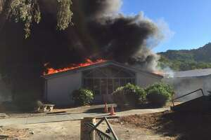 Flames engulf a building at Dixie Elementary School in San Rafael.