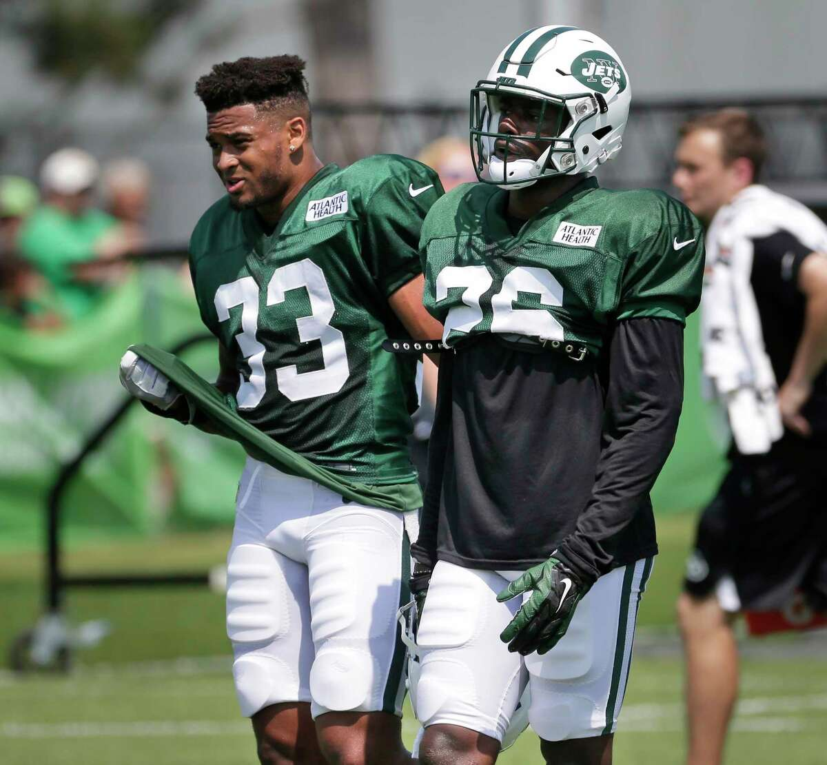 New York Jets' safeties Marcus Maye, right, and Jamal Adams walk together during a NFL football training camp in Florham Park, N.J., Monday, July 31, 2017. (AP Photo/Seth Wenig) ORG XMIT: NJSW113
