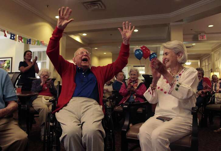 """Family, friends and members of Brooksdale Alamo Heights, a local senior care center, sing """"Happy Birthday"""" to Jerry Spengler as he celebrates his 100th birthday."""