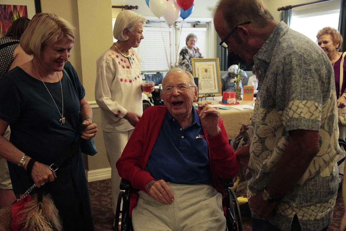Friends and family give Jerry Spengler blessings on his birthday Monday.
