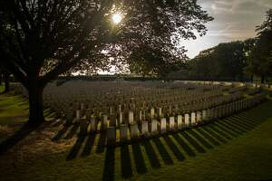 YPRES, BELGIUM - AUGUST 01:  The setting sun creates long shadows in front of the graves at Sanctuary Wood Military Cemetery on August 1, 2014 in Ypres, Belgium. Monday 4th August marks the 100th anniversary of Great Britain declaring war on Germany. In 1914 British Prime Minister Herbert Asquith announced at 11 pm that Britain was to enter the war after Germany had violated Belgium neutrality. The First World War or the Great War lasted until 11 November 1918 and is recognised as one of the deadliest historical conflicts with millions of causalities. A series of events commemorating the 100th anniversary are taking place throughout the day.  (Photo by Christopher Furlong/Getty Images)