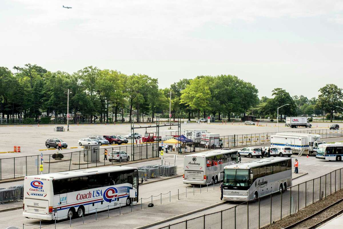 Buses sit idly during a calm rush hour of commuters at Belmont Park in Elmont, N.Y., July 10, 2017. Substantial repairs began at New York?'s Pennsylvania Station on Monday, but ample alternative transportation and extensive guidance from transit agencies resulted in a relatively smooth morning commute. (Johnny Milano/The New York Times) ORG XMIT: XNYT17
