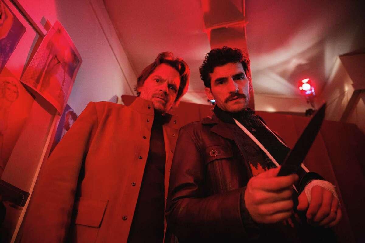 Florin Piersic Jr. (left) and Cor neliu Ulici pursue a killer in