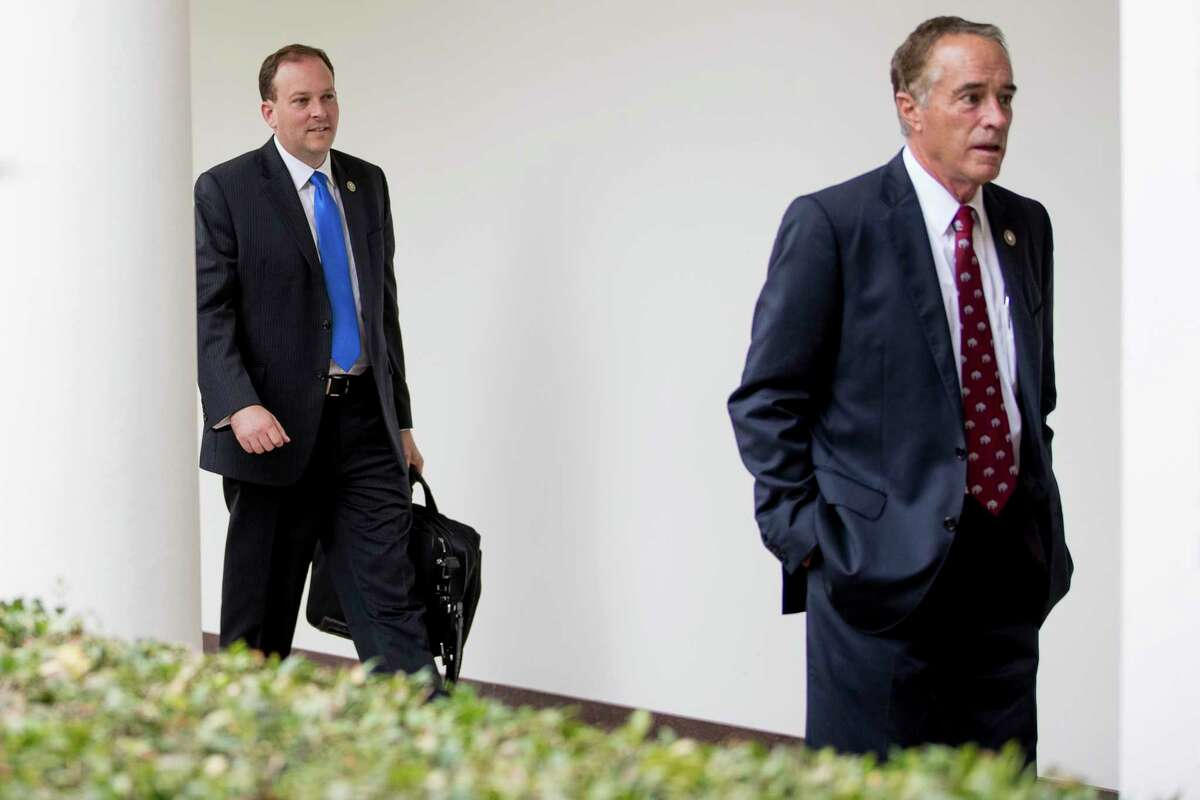 Rep. Lee Zeldin, R-N.Y. left, follows Rep. Chris Collins R-N.Y., walk through the colonnade from the West Wing into the White House in Washington, Friday, July 28, 2017. (AP Andrew Harnik) ORG XMIT: DCAH104