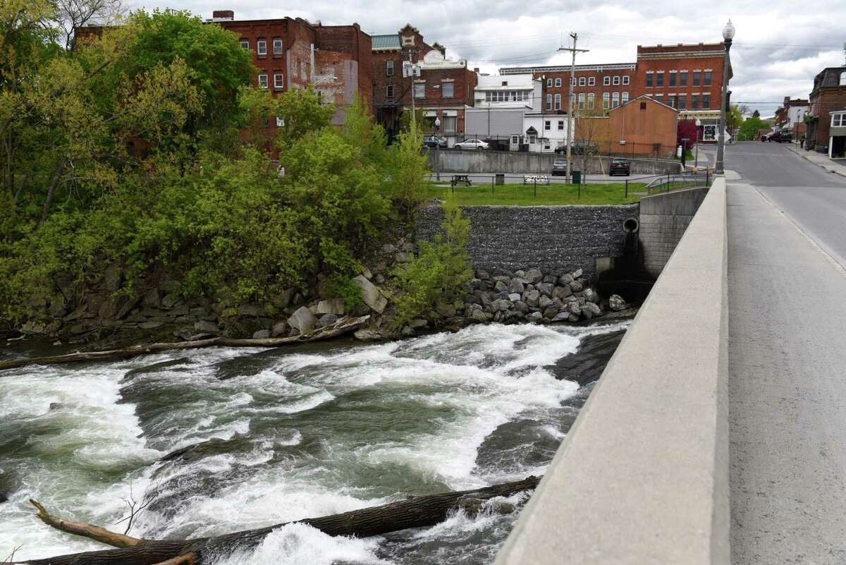 The Hoosic River flows under Church Street on Wednesday, May, 10, 2017, in Hoosick Falls, N.Y. (Will Waldron/Times Union)