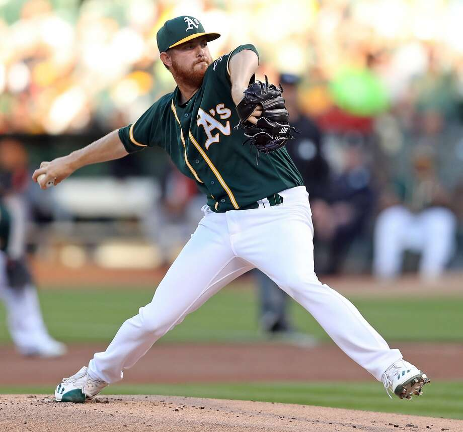 Oakland Athletics' Paul Blackburn delivers to San Francisco Giants in 1st inning during MLB game at Oakland Coliseum in Oakland, Calif. on Monday, July 31, 2017. Photo: Scott Strazzante / The Chronicle