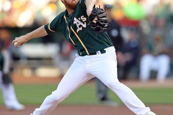 Oakland Athletics' Paul Blackburn delivers to San Francisco Giants in 1st inning during MLB game at Oakland Coliseum in Oakland, Calif. on Monday, July 31, 2017.