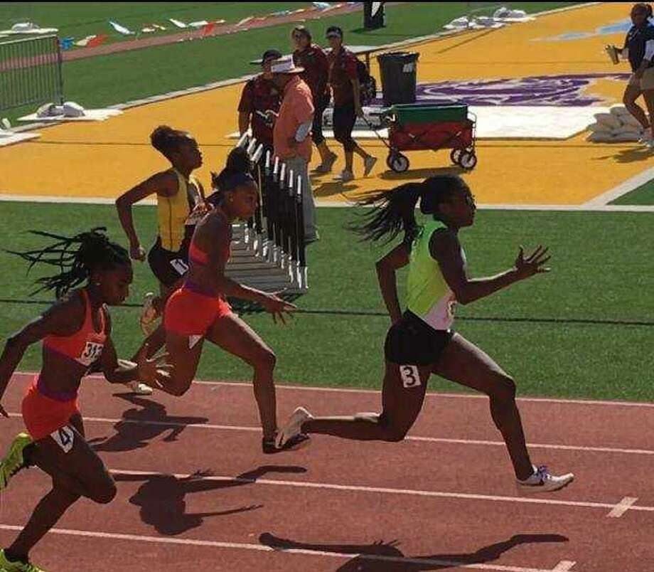 Alexander's Cynthia Emeremnu improved on her qualifying time by 0.17 seconds to finish first in the 100-meter dash at the T.A.A.F. Games of Texas State Track and Field Meet. Photo: Courtesy Photo