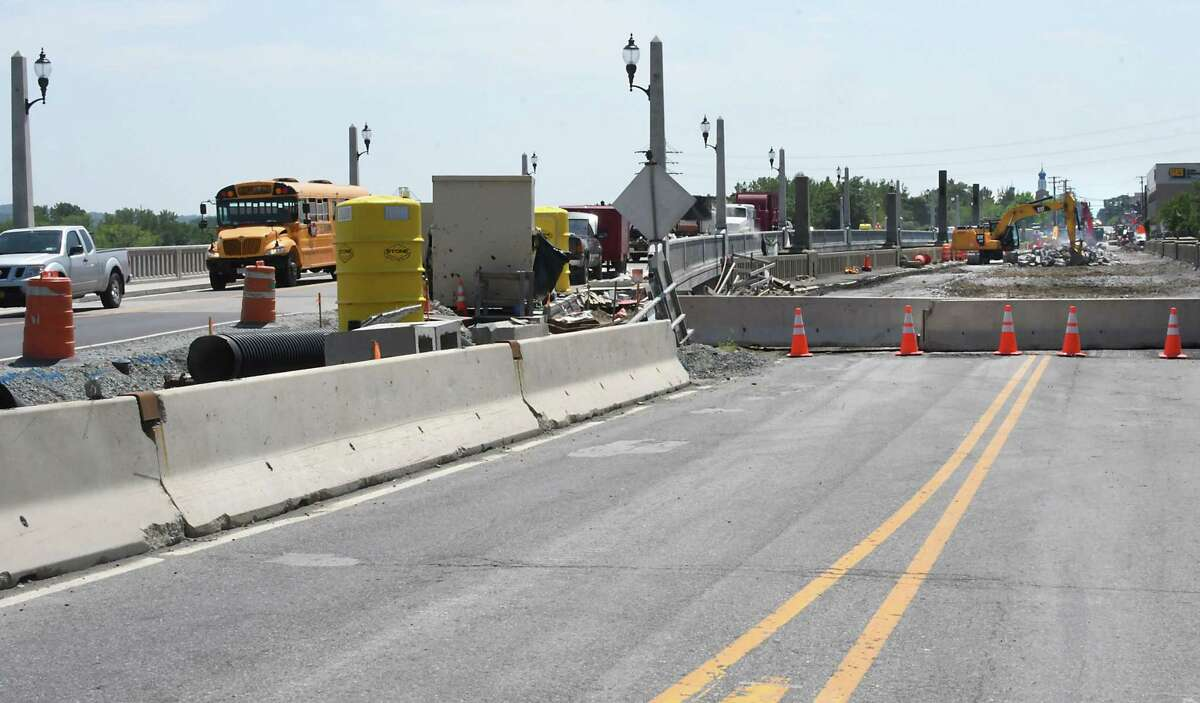 Cars cross the newly opened bridge connecting Cohoes and Waterford, on left, while crews rip apart the old bridge on Monday, July 31, 2017 in Cohoes, N.Y. (Lori Van Buren / Times Union)