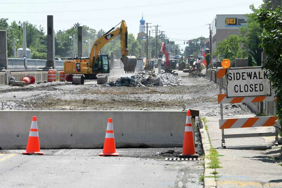 Cars cross the newly opened bridge connecting Cohoes and Waterford, on left, while crews rip apart the old bridge on Monday, July 31, 2017 in Cohoes, N.Y. (Lori Van Buren / Times Union) Photo: Lori Van Buren / 0041160A