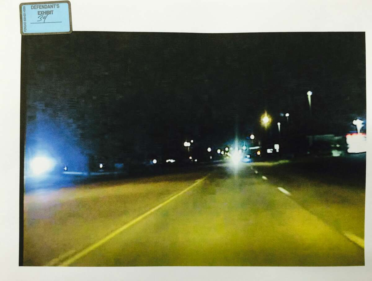 An image from Pearland Police Officer Endy Ekpanya's patrol car, 8 seconds before the June 12, 2016 crash that killed him. Amber Willemsen's headlights can be seen approaching in the distance. Willemsen is charged with intoxication manslaughter in connection with the wreck.