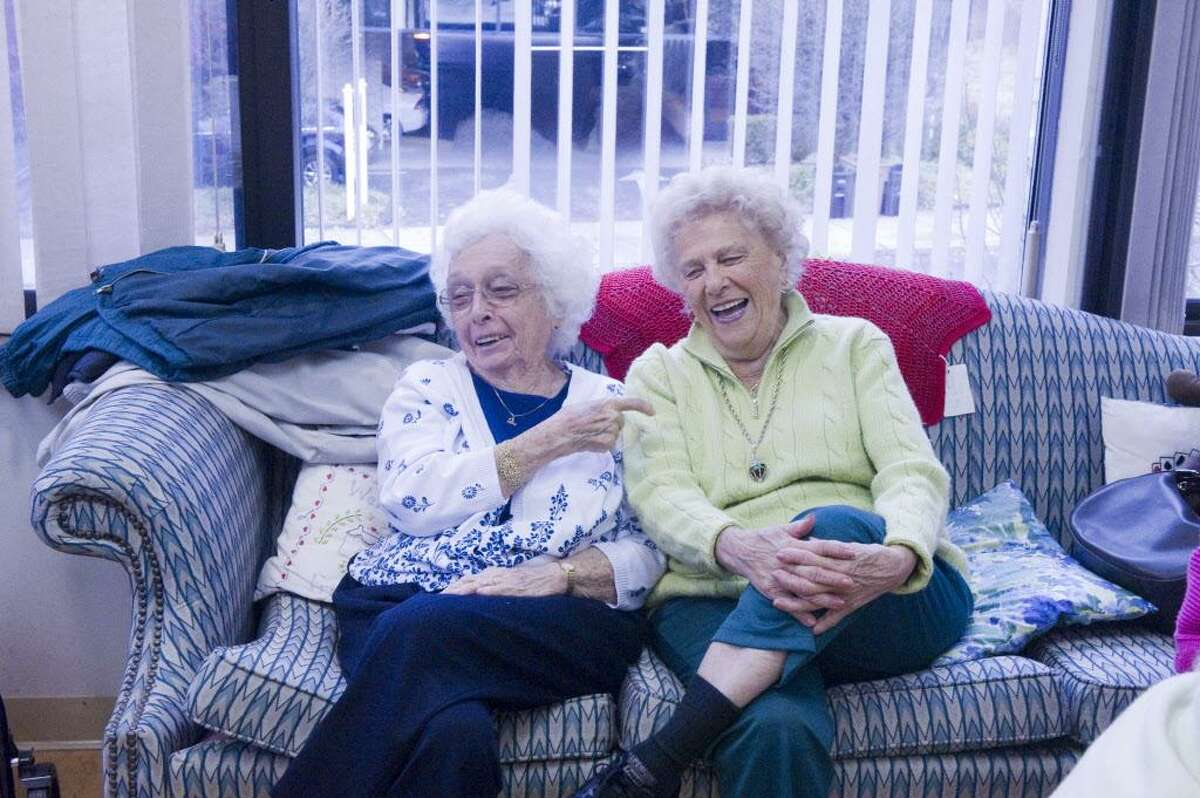 Sisters Kay Walters, 92, left, and Fran Salvatore, 89, share a laugh while spending the day with the