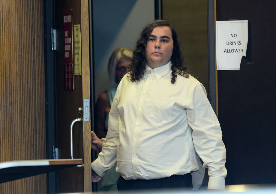 Triston Miller exits Raquel Wests' courtroom Monday after a trial announcement for allegedly making terroristic threats towards Port Neches-Groves High School earlier this year. Photo taken Monday, July 10, 2016 Guiseppe Barranco/The Enterprise Photo: Guiseppe Barranco, Photo Editor / Internal