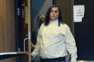 Triston Miller exits Raquel Wests' courtroom Monday after a trial announcement for allegedly making terroristic threats towards Port Neches-Groves High School earlier this year. Photo taken Monday, July 10, 2016 Guiseppe Barranco/The Enterprise