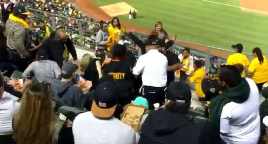 Athletics investigating fight between security guard, female fan