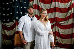 Manready Mercantile owner Travis Weaver, left, and Emerson Rose owner Bonnie Reay show off their looks for White Linen Night Tuesday, July 25, 2017 in Houston.