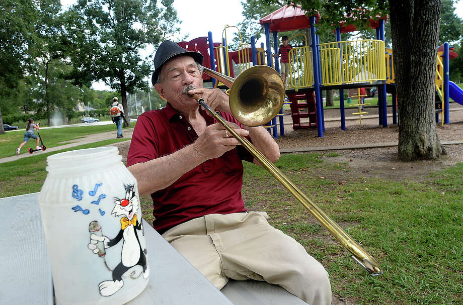 Henry Pressler, who performed with various bands and in duos under the stage name of Tony Alamo, continues to entertain with a variety of jazz and crooner classics. Pressler often spends afternoons in Rogers Park, his old fedora atop his head and trombone in hand. He still carries with him the tip jar his daughter decorated for him when she was a young child. Photo taken Wednesday, July, 26, 2017 Kim Brent/The Enterprise Photo: Kim Brent / BEN