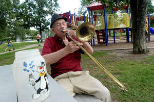 Henry Pressler, who performed with various bands and in duos under the stage name of Tony Alamo, continues to entertain with a variety of jazz and crooner classics. Pressler often spends afternoons in Rogers Park, his old fedora atop his head and trombone in hand. He still carries with him the tip jar his daughter decorated for him when she was a young child. Photo taken Wednesday, July, 26, 2017 Kim Brent/The Enterprise