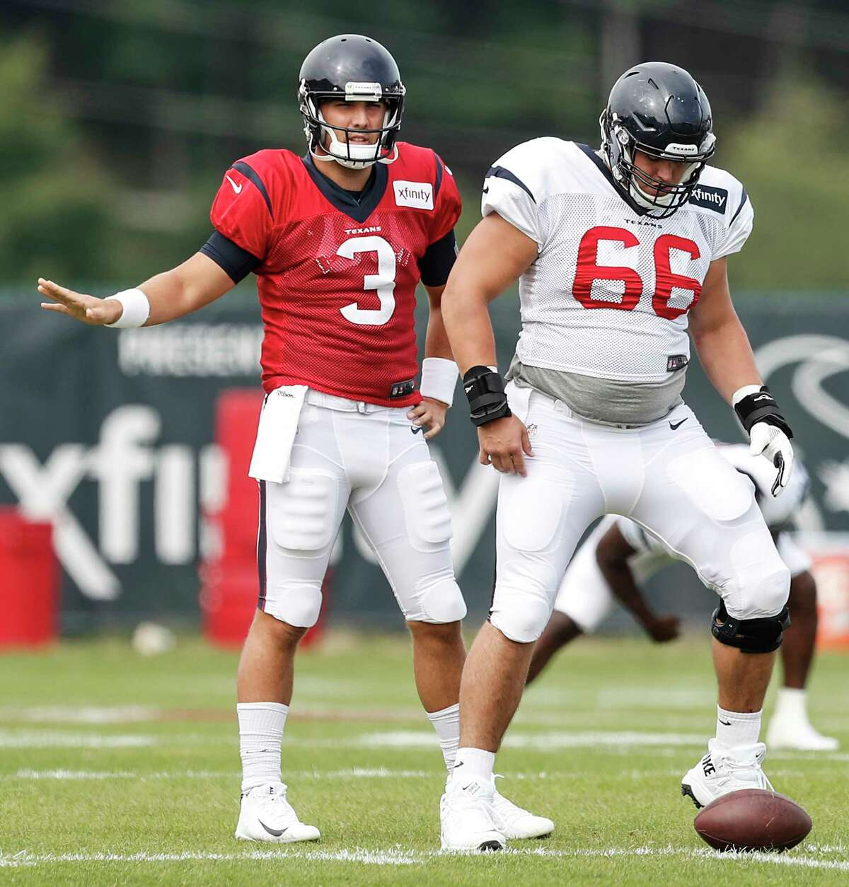 Houston Texans quarterback Tom Savage (3) lines up behind center Nick Martin (66) during training camp at the Greenbrier on Tuesday, Aug. 1, 2017, in White Sulphur Springs, W.Va.