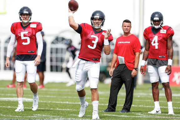 Houston Texans quarterback Tom Savage (3) is flanked by quarterbacks Brandon Weeden (5) and Deshaun Watson (4) as he throws a pass during training camp at the Greenbrier on Tuesday, Aug. 1, 2017, in White Sulphur Springs, W.Va.