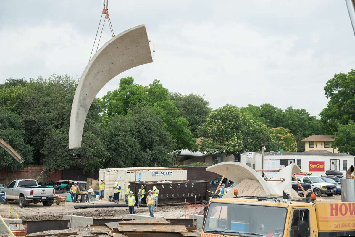 Photos show a crane placing part of a pavilion in Confluence Park in July 2017.