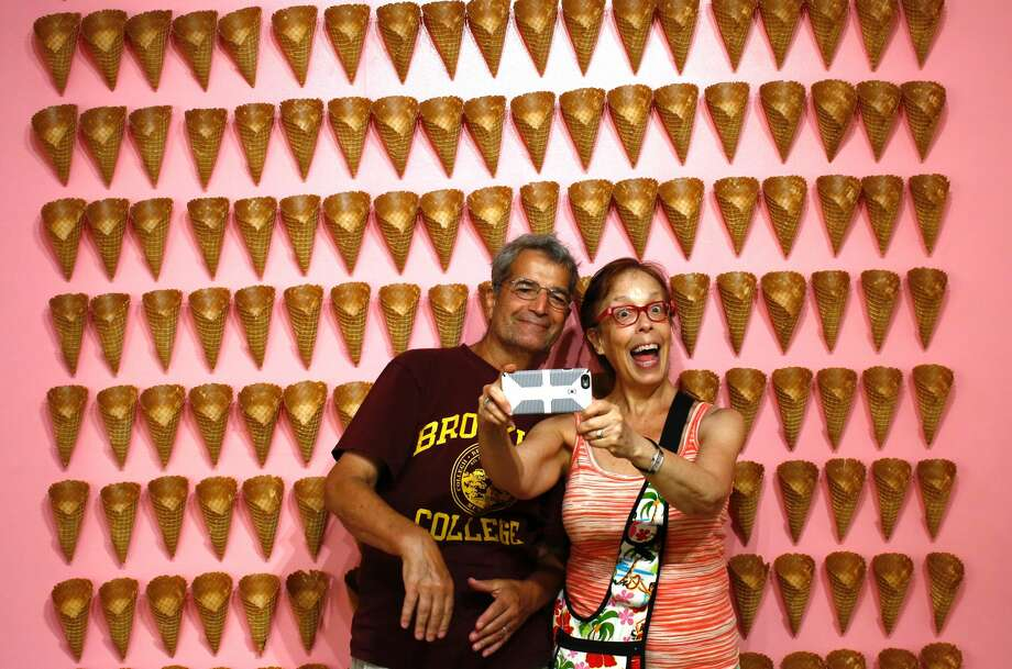 Visitors pose as they visit the Museum of Ice Cream across from the Whitney Museum on July 29, 2016 in New York City The temporary museum dedicated to all things ice cream will be open for the month of August. Photo: Kena Betancur/Getty Images