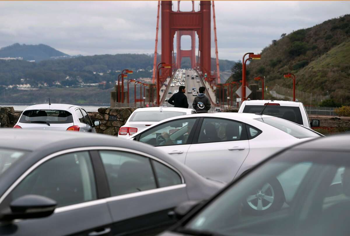 A motorist hunts for a parking space at the north vista point of the Golden Gate Bridge in Sausalito, Calif. on Saturday, Jan. 9, 2016. During peak times, northbound traffic attempting to exit into the vista point's parking lot often backs up, creating significant congestion coming off the bridge.