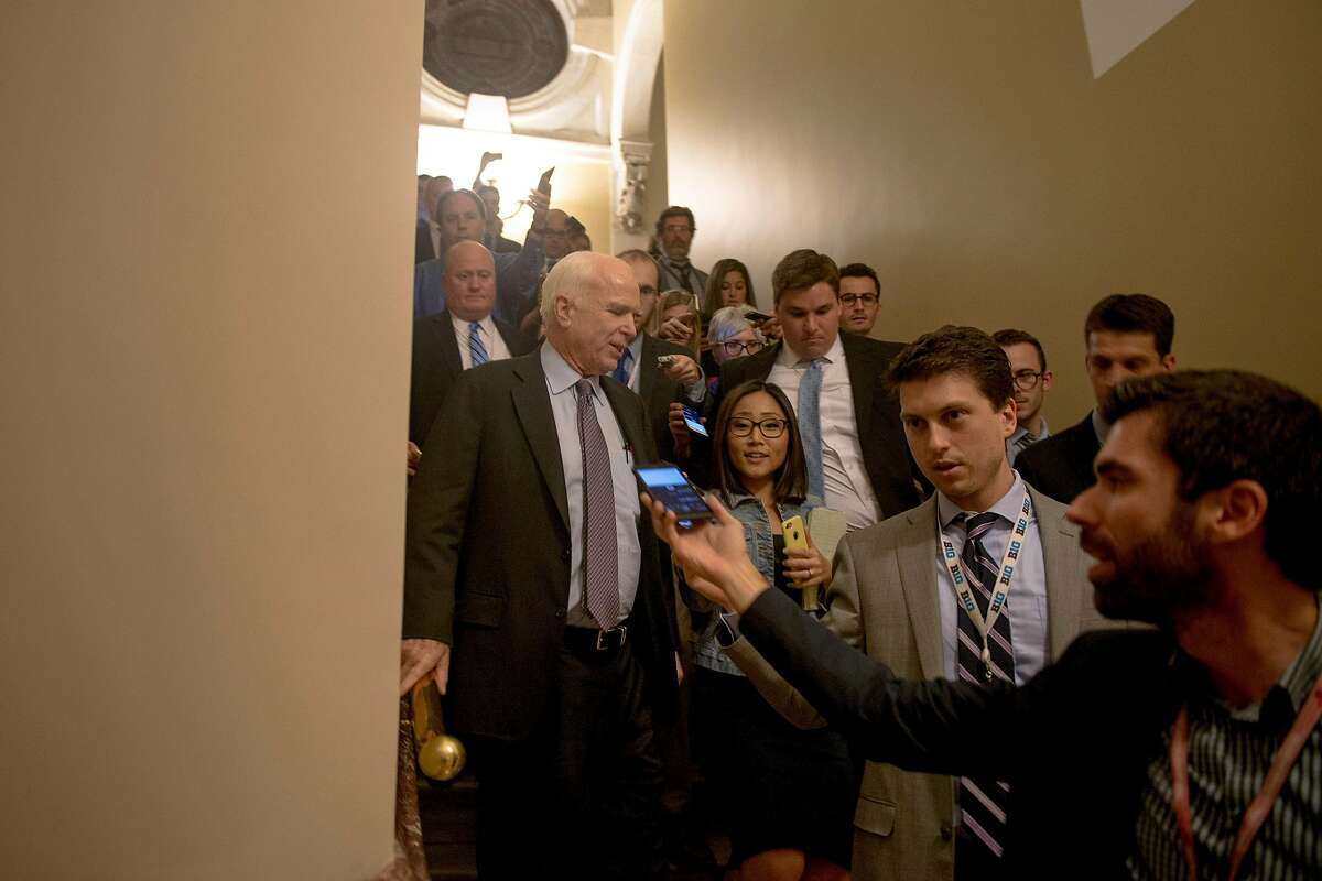 Sen. John McCain (R-Ariz.) speaks to reporters after voting against a slimmed-down Affordable Care Act repeal measure on Capitol Hill, in Washington, in the early morning hours on July 28, 2017. The party�s senators trimmed their vision of a bill to repeal the health law, but McCain and two other Republicans turned on the bill in the dead of night. (Gabriella Demczuk/The New York Times)