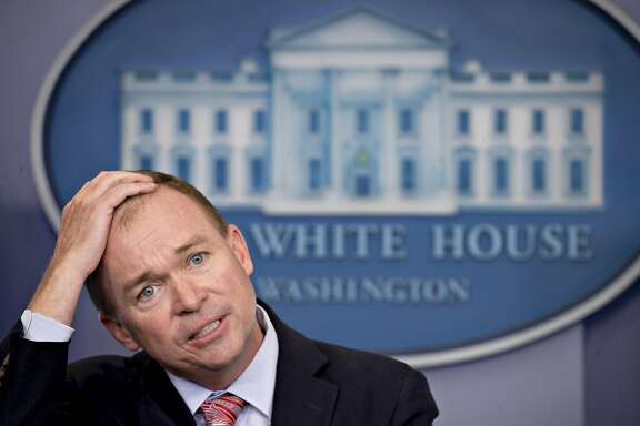 "Mick Mulvaney, director of the Office of Management and Budget (OMB), pauses while speaking during a White House press briefing in Washington, D.C., U.S., on Thursday, July 20, 2017. Mulvaney has called Trump's tax-cutting approach to the economy MAGAnomics, a spin on Trump's campaign slogan, ""Make America Great Again"" and has repeatedly attacked the Congressional Budget Office (CBO) for its estimates on the impact of Republicans' plans to repeal and replace Obamacare. Photographer: Andrew Harrer/Bloomberg"