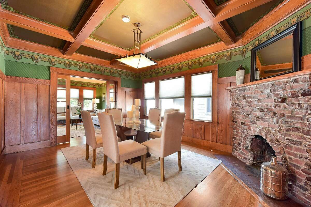 A clinker brick fireplace awaits in the formal dining room.