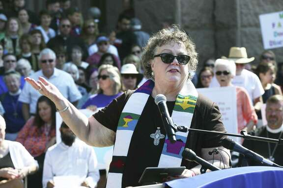 """General Presbyter Sallie Sampsell Watson, of Mission Presbytery in San Antonio, gestures to include all in attendance as leaders from a broad coalition of religious groups demonstrate on the steps of the Capitol against Senate Bill 3 and other """"bathroom bill"""" on August 1, 2017."""