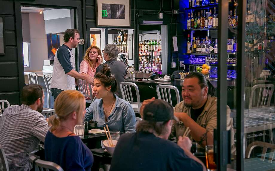 People have dinner at Moshi Moshi in S.F. Photo: John Storey, Special To The Chronicle