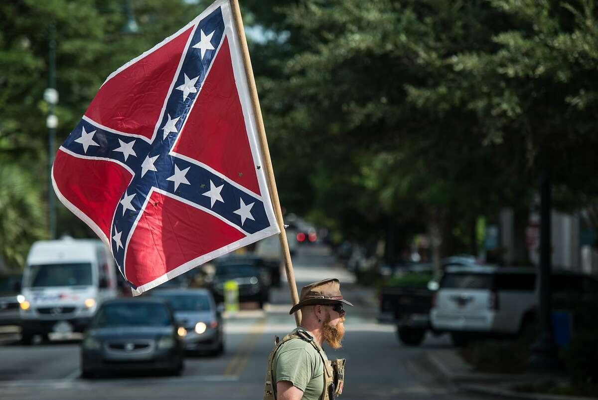 COLUMBIA, SC - JULY 10: A Confederate flag supporter arrives at the South Carolina Statehouse on July 10, 2017 in Columbia, South Carolina. To mark the two year anniversary of the removal of the Confederate battle flag from statehouse grounds, demonstrators erected a pole and flew a replica for several hours at its former location. (Photo by Sean Rayford/Getty Images)