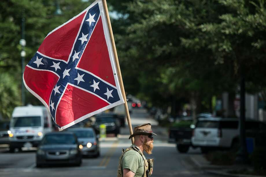 """A monument to Confederate war dead, erected in city-owned Travis Park in 1899, says """"Lest We Forget"""" and """"Our Confederate Dead."""" To many, this is an affront. To others, it's a way to honor history. Photo: Sean Rayford, Getty Images"""
