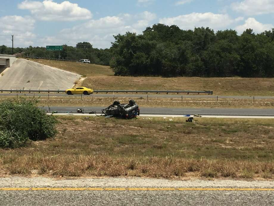 The southbound lanes of Intestate 37 have been shut down while crews clear a wreck on Tuesday, Aug. 1, 2017. Several items appear to have been ejected from the car during the roll over, including a car seat. Photo: Fares Sabawi / San Antonio Express-News