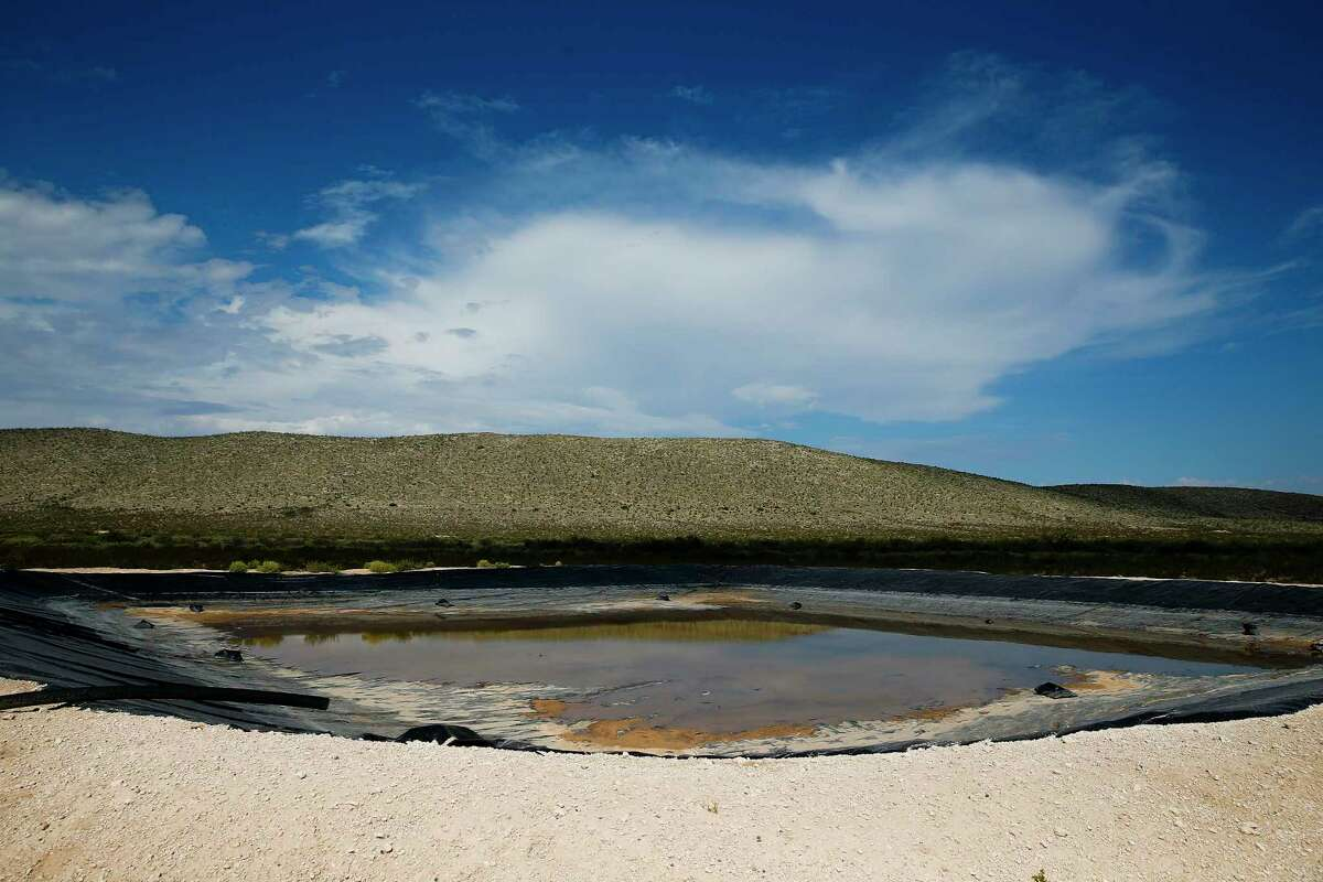 Water from a well fills a retention pond at the Apache Ranch Tuesday, July 18, 2017 in Van Horn. Landowner Dan Hughes hopes to drill for and pump as much as 6,000 acre feet of water per year from his property for use in hydraulic fracturing operations. ( Michael Ciaglo / Houston Chronicle )