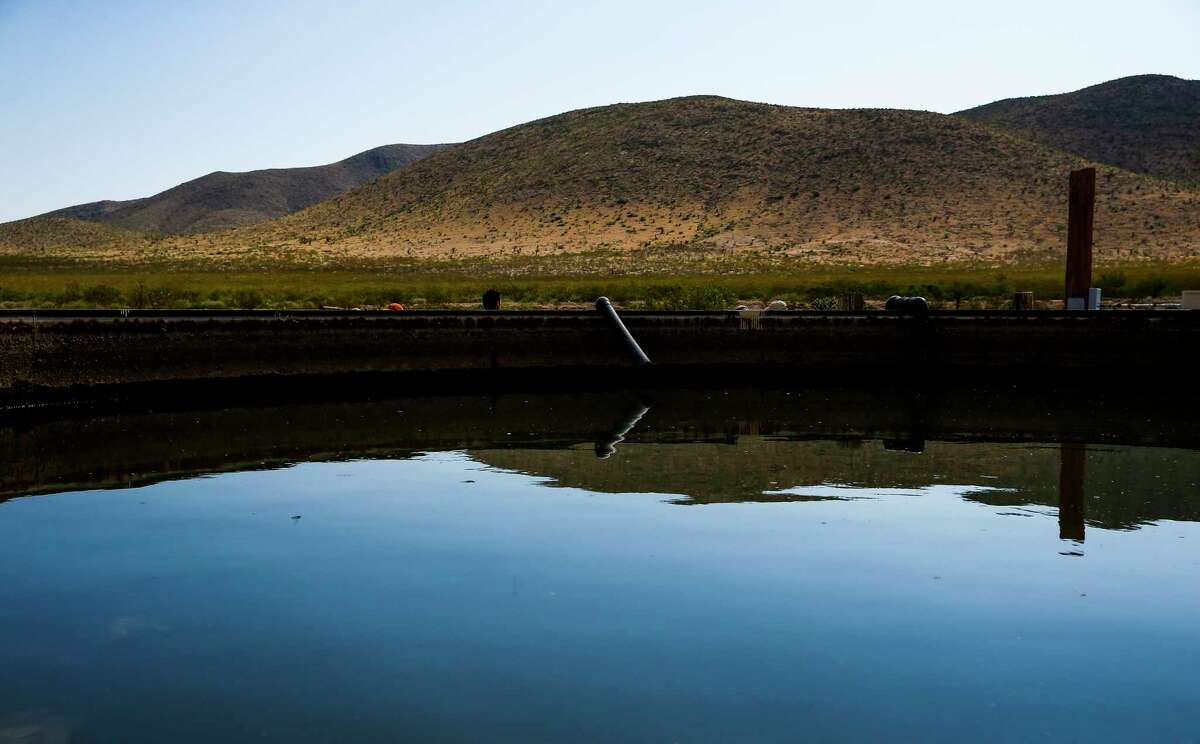 Water from a well on the Apache Ranch in Van Horn is stored in a holding tank last month.