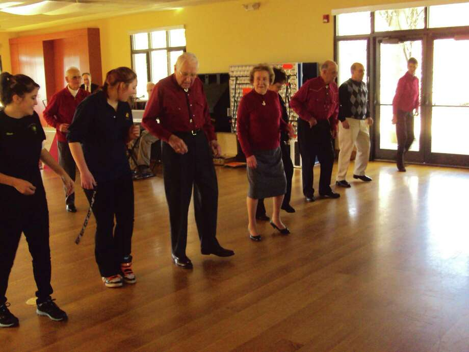 RICKY CAMPBELL / Register Citizen  Litchfield seniors teach culinary students from Oliver Wolcott Tech a few moves on the dance floor of the Litchfield Community Center, Thursday afternoon.