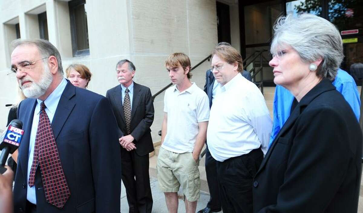 Attorney Joseph Mirrione, left, speaks to the media after the sentencing of Arthur King Hall for his role in a 2009 fatal boating accident while intoxicated in front of Superior Court in New Haven. At right is Jean Cook, the mother of Jonathan Cook who died in the accident, standing with other victims' families. Photo by Arnold Gold/New Haven Register