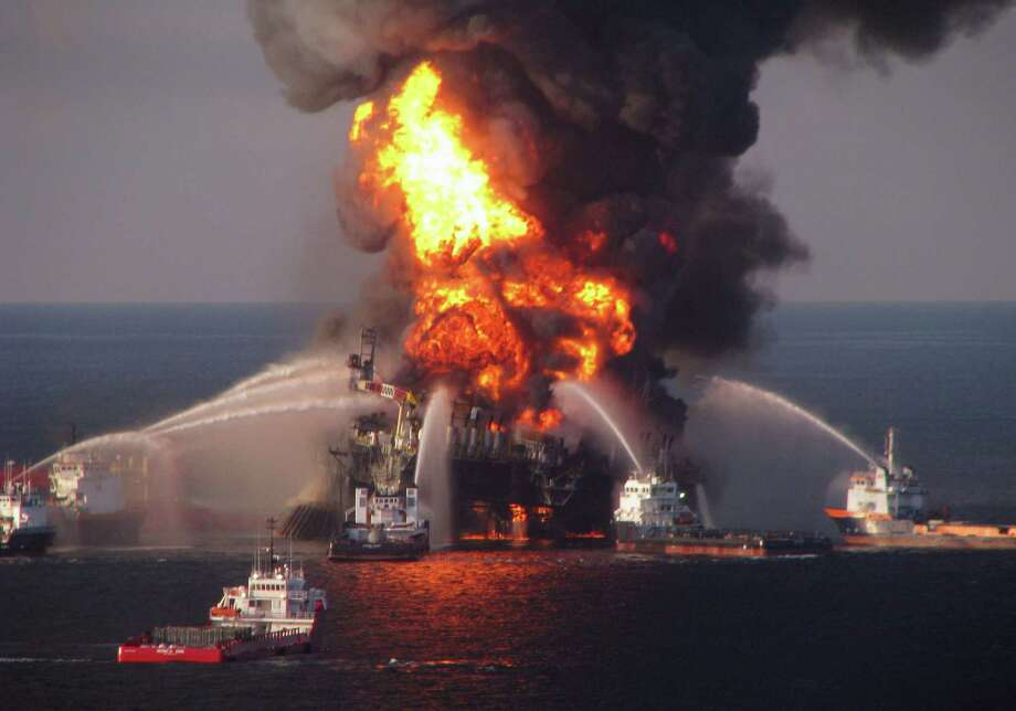 In this April 21, 2010 photo provided by the U.S. Coast Guard, fire boat response crews spray water on the burning BP Deepwater Horizon offshore oil rig. An April 20, 2010 explosion at the platform killed 11 men, and the subsequent leak released an estimated 172 million gallons of petroleum into the gulf. Photo: Associated Press File Photo / U.S. Coast Guard