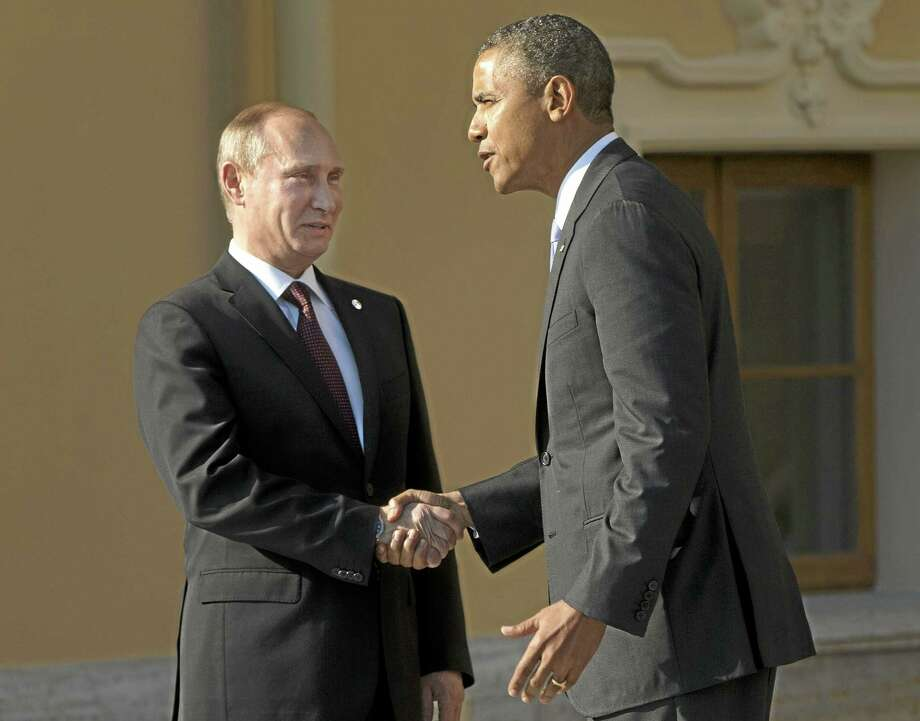 """FILE - In this Sept. 5, 2013 pool-file photo, President Barack Obama shakes hands with Russia's President Vladimir Putin during arrivals for the G-20 summit at the Konstantin Palace in St. Petersburg, Russia. """"We've kind of hit a wall,"""" President Barack Obama said on his way to Russia last week. He meant his relationship with Moscow, but the remark came to apply, too, to other leaders abroad, lawmakers at home and even Americans at large, all standing in the way of his plans to punish Syria for using chemical weapons. Just days later, military action is on hold, diplomacy has some steam and Obama no longer looks so alone. (AP Photo/Pablo Martinez Monsivais, Pool-File) Photo: AP / AP Pool"""
