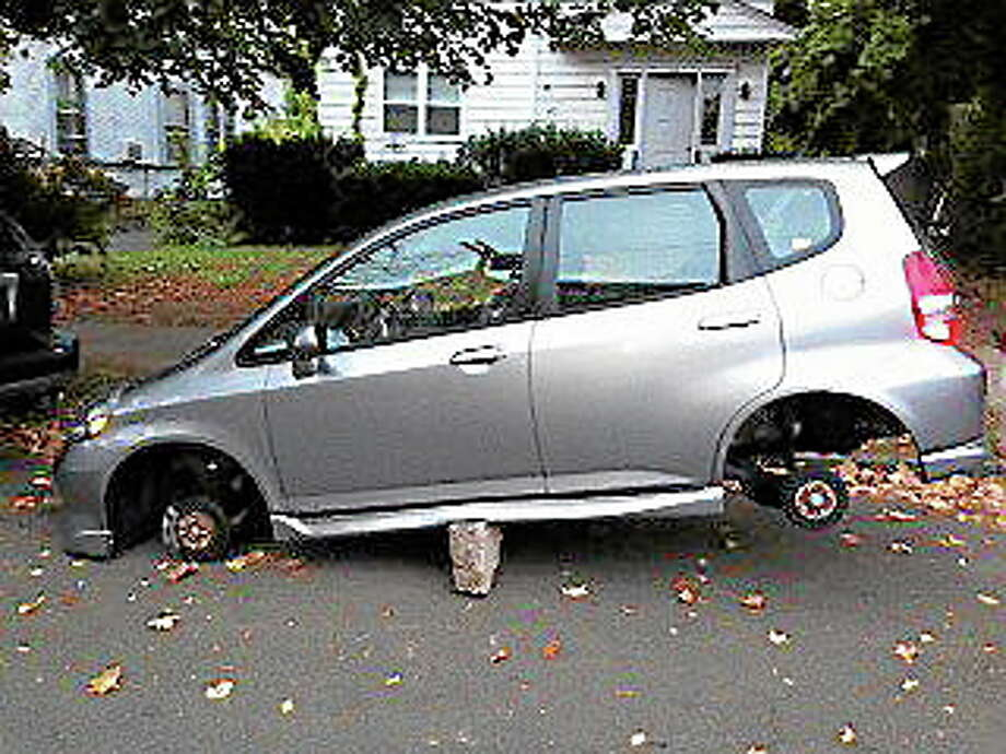 A Honda Fit's tires were stolen on Cottage Street in New Haven. Photo: Mindi Englart — Contributed Photo