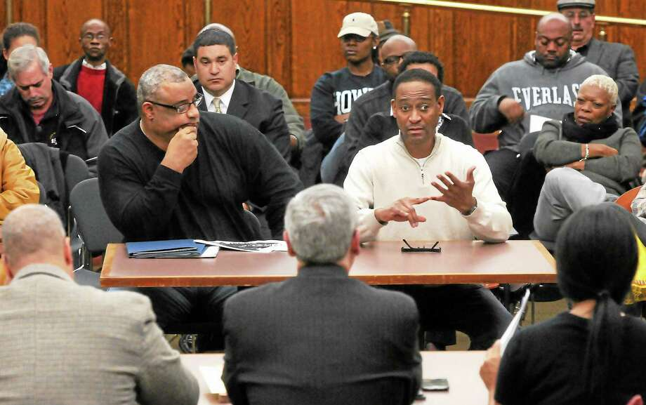 (Mara Lavitt ó New Haven Register)   December 9, 2013 New Haven  Mayor-elect Toni Harp's sub-committee on public safety held a meeting to hear from the public. Fire Lt. Gary Tinney, left, and FireFighter Darrell Brooks outline their concerns to the sub-committee, including from left, Jason Bartlett, Bill Carbone, and Dina O'Neil. Brooks discusses needing a new chief to get the department on the right track for the 21st century. Photo: Journal Register Co. / Mara Lavitt