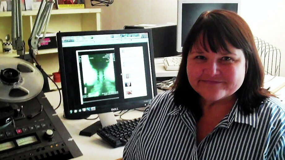 Shelley Merrill of Norwich poses next to an X-ray of her neck, showing some of the injuries she suffered after a drunk driver crashed into the vehicle in which she was a passenger in 2007. Photo: CONTRIBUTED PHOTO