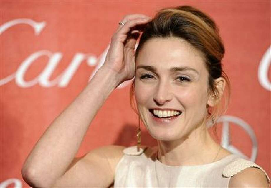 French actress Julie Gayet poses at the 2012 Palm Springs International Film Festival Awards Gala, in Palm Springs, Calif. French President Francois Hollande is threatening legal action over magazine report saying that he is having a secret affair with the French actress. Photo: AP / AP