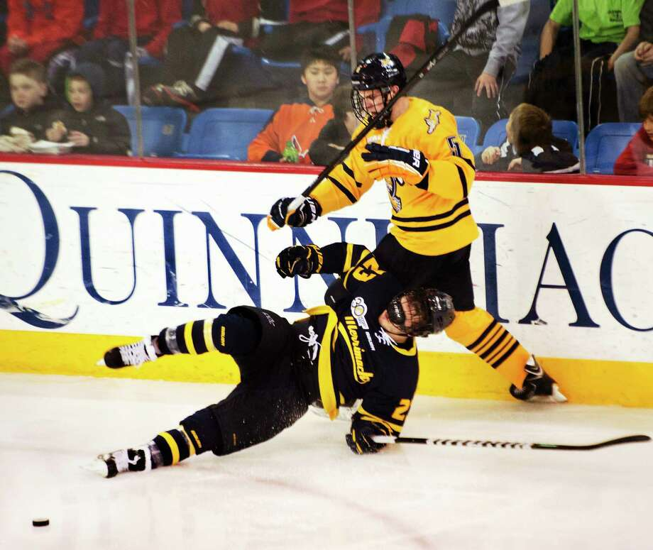 Quinnipiac's Devon Toews checks Merrimack's Josh Meyers during the second period of the fifth-ranked Bobcats' 6-1 win Friday night in Hamden. The two teams played again Saturday in North Andover, Mass. Photo: Melanie Stengel — Register