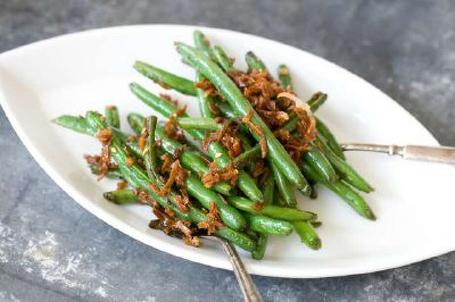 Green beans with a sweet and spicy coconut topping.